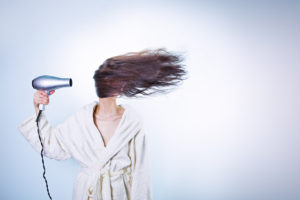 woman-morning-bathrobe-blow-drying